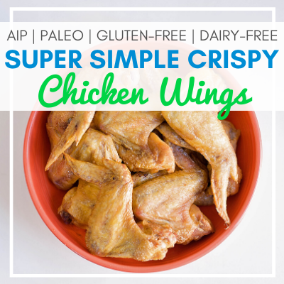 bowl of chicken wings with text overlay - AIP, Paleo, Gluten-Free, Dairy-Free Super Simple Crispy Chicken Wings
